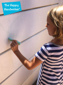 the-happy-handwriter-drawing-on-a-vertical-surface