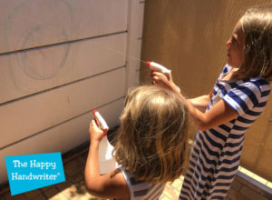 the-happy-handwriter-spraying-the-wall-clean